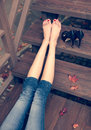 Very Beautiful Long Legs, A Girl Is Resting After A Long Walk Sitting On The Steps A Warm Autumn Evening Royalty Free Stock Photo - 60398475