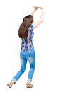 Back View Of Woman  Protects Hands From What Is Falling From Abo Stock Images - 60415824
