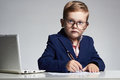 Business Boy. Funny Child In Glasses Writing Pen. Little Boss In Office Stock Photo - 60430400