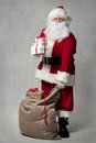 Santa Claus With A Bag Of Presents Royalty Free Stock Image - 60434466