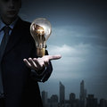 Bulb In Hand Stock Images - 60445154