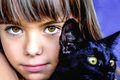Portrait Of A Beautiful Little Girl Holding A Black Cat Royalty Free Stock Photography - 60458457