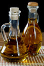 Two Bottles Of Olive Oil On  Table Stock Image - 60459621