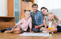 Girls Playing With Parents At Board Game On Floor Stock Photos - 60468543