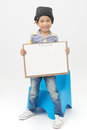 Happy Asian Boy Holding A Blank Art Board Royalty Free Stock Images - 60469159