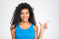 Cheerful African Woman Pointing Finger Away Royalty Free Stock Image - 60473116