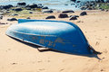 Old Blue Rowboat Lays On Sandy Beach Stock Photos - 60489473