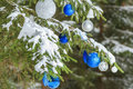 Christmas Festive Glitter Baubles Silver And Blue Ornaments Outside On Snowy Spruce Branches Royalty Free Stock Photo - 60526585