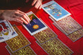 Fortune Teller Using Tarot Cards Royalty Free Stock Photo - 60538915