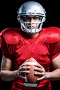 Portrait Of Serious American Football Player Holding Ball Royalty Free Stock Photography - 60541037