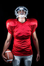 American Football Player Holding Ball While Looking Up Stock Photo - 60541300