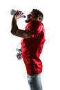 American Football Player In Red Jersey Holding Helmet While Drinking Water Stock Photo - 60543020
