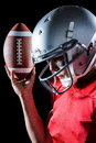 Sportsman Looking Down While Holding American Football Stock Image - 60544191