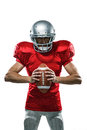 Furious American Football Player In Red Jersey And Helmet Holding Ball Royalty Free Stock Photo - 60545645
