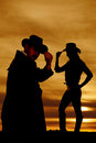 Silhouette Of A Cowgirl Side Touch Hat Look Down Cowboy. Royalty Free Stock Photo - 60556485
