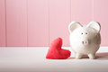 Piggy Bank With Red Heart Pillow Royalty Free Stock Photo - 60593965