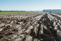 Converging Furrows In Partially Plowed Clay Soil Royalty Free Stock Photos - 60619798