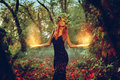Elegant Redhair Girl Witch Conjures In The Magic Forest Royalty Free Stock Photography - 60642277