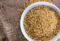 Raw Bulgur (on Wooden Background) Stock Photography - 60652612
