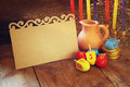 Image Of Jewish Holiday Hanukkah With Menorah (traditional Candelabra) And Wooden Dreidels (spinning Top) With Empty Card  Stock Image - 60658691