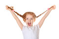 Laughing Girl Pull Her Pigtails Up By Hand And Show Her Teethes. Royalty Free Stock Photo - 60666105