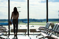 Young Woman Near Window In An Airport Lounge Royalty Free Stock Photos - 60686388