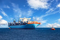 Tugboat Towing Container Ship Royalty Free Stock Image - 60697896