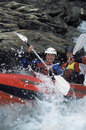 Two People Paddling Inflatable Boat Down Rapids Stock Image - 6075721