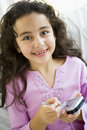 Middle Eastern Girl Using A PDA Royalty Free Stock Images - 6079639
