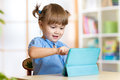 Child Girl Playing With A Digital Tablet At Home Stock Photos - 60703403