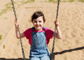 Happy Little Girl Swinging On Swing At Playground Stock Images - 60722774