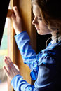 Young Woman In Blue Vintage Dress Standing Near Window In Coupe Stock Photography - 60743872