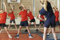 Teacher Taking Exercise Class In School Gym Royalty Free Stock Images - 60751629