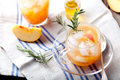 Peach And Rosemary Fizz Cocktail Royalty Free Stock Image - 60760036