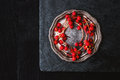 Red Berries Sprig In The Vintage Metal Plate On The Black Stone Stock Photo - 60762720