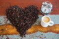 Heart Shape Coffee Beans And Cup Of Coffee And Alarm Clock Royalty Free Stock Photo - 60765295