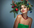 Girl In A Wreath Of Fir Branches Royalty Free Stock Images - 60787589