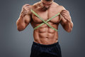 Bodybuilder Measuring Waist With Tape Measure Stock Image - 60802111