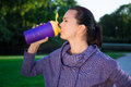 Close Up Of Fitness Woman Drinking Water From Bottle In Park Royalty Free Stock Image - 60803556