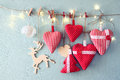 Christmas Image Of Fabric Red Hearts And Tree. Wooden Reindeer And Garland Lights, Hanging On Rope Royalty Free Stock Images - 60816699