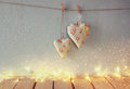 Low Key Image Of Christmas Image Of Fabric Hearts Hanging On Rope In Front Of Wooden Background. Retro Filtered Stock Image - 60818731