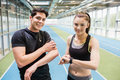 Fit Couple On The Indoor Track Stock Images - 60827414