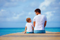 Father And Son Sitting On Pier And Talk Stock Image - 60829011