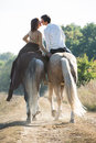 Young Couple In Love Riding A Horse Stock Photo - 60842680