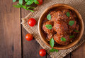 Meatballs In Sweet And Sour Tomato Sauce And Basil In A Wooden Bowl Stock Photo - 60860140