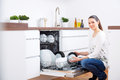 20s Woman In Kitchen, Empty Out The Dishwasher 3 Stock Photos - 60870173