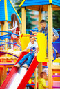 Group Of Happy Kids Sliding On Colorful Playground Royalty Free Stock Images - 60871879