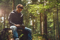 Young Man Using A Digital Tablet In The Woods Stock Image - 60875211