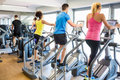 Fit People Working Out Using Machines Stock Photo - 60893440