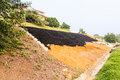 Slope Erosion Control With Grids And Earth On Steep Slope Stock Image - 60900571